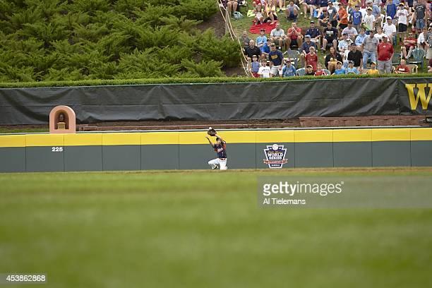 Little League World Series Southeast Region Team Eston Snider of South Nashville LL in action fielding pop fly vs MidAtlantic Region Team of Taney...