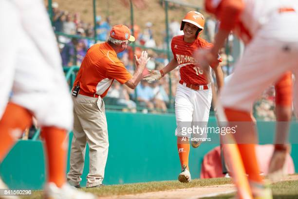 Little League World Series USA Southwest Region Hunter Ditsworth in action victorious after hitting homerun vs Japan Region during Championship Game...
