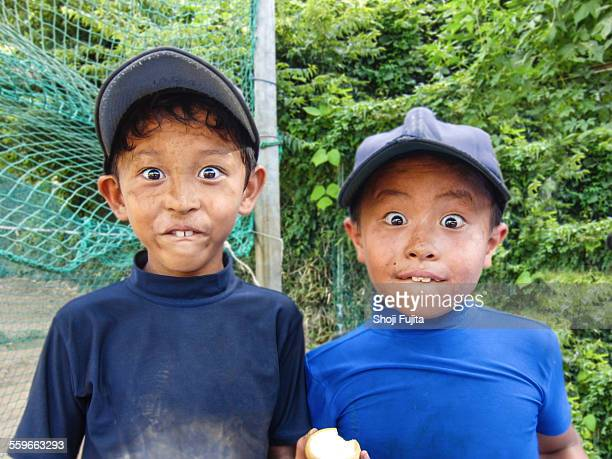 youth baseball players making funny face