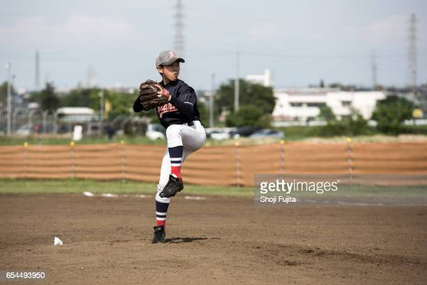 youth baseball players, pitcher - baseball pitcher stock pictures, royalty-free photos & images