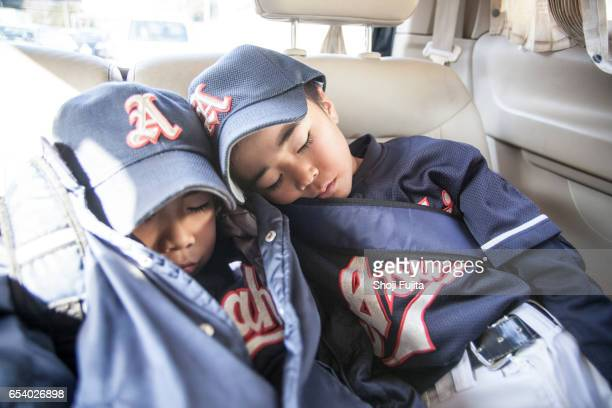 Youth Baseball Players, taking a break in the car
