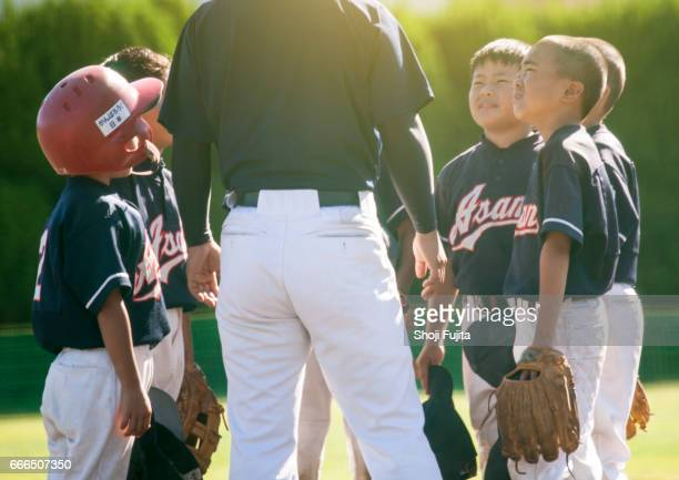 youth baseball players, teammates,coach - baseball sport stock pictures, royalty-free photos & images