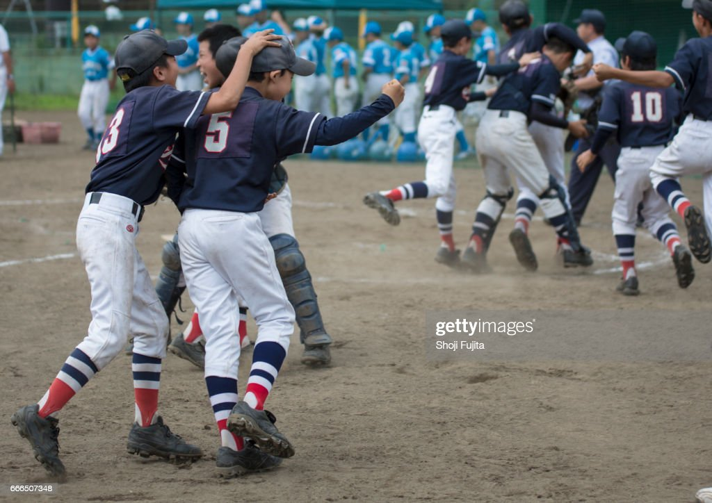 Youth Baseball Players, Teammates,win the game : Stock Photo