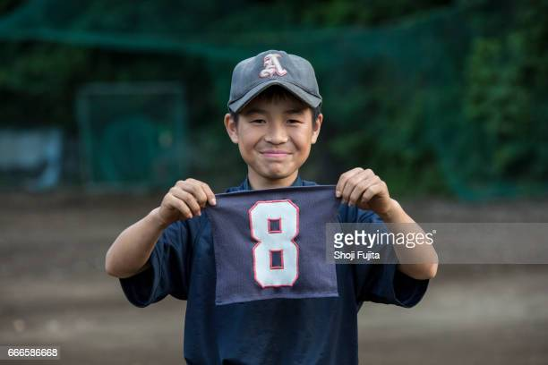 youth baseball players, uniform number - number 8 stock pictures, royalty-free photos & images