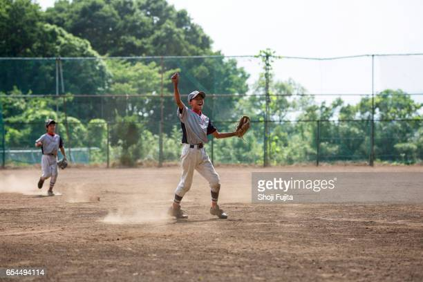 youth baseball players,action - baseball team stock pictures, royalty-free photos & images