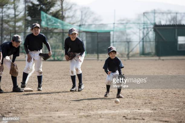 Youth Baseball Players,Defensive practice with sister