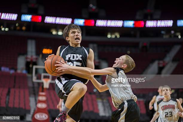 PDX Youth Basketball player Ian Downey drives to the basket at the Rose Garden Arena