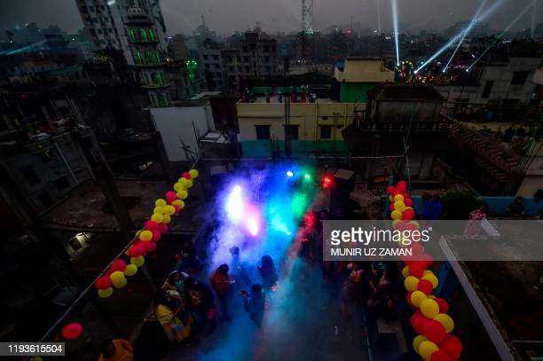 Youth celebrate with lights during the Shakrain festival or the Kite festival in Dhaka on January 14 2020 Shakrain Festival is an annual celebration...