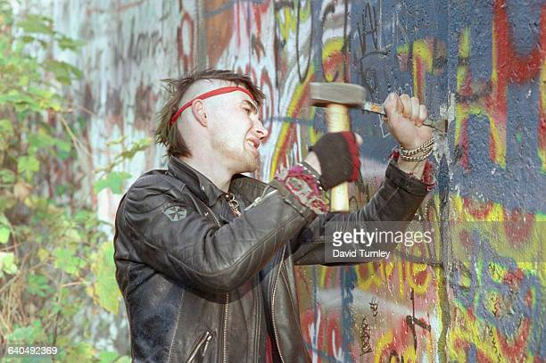Youth Chipping Away at Berlin Wall