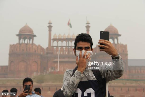 Youth click selfie in front of red Fort in Delhi on 12 Novemeber 2017 Air pollution levels skyrocketed by the hour in Delhi on Sunday turning the air...
