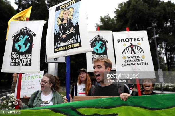 Youth climate activists hold signs during a Climate Strike youth protest outside of Chevron headquarters on September 27, 2019 in San Ramon,...
