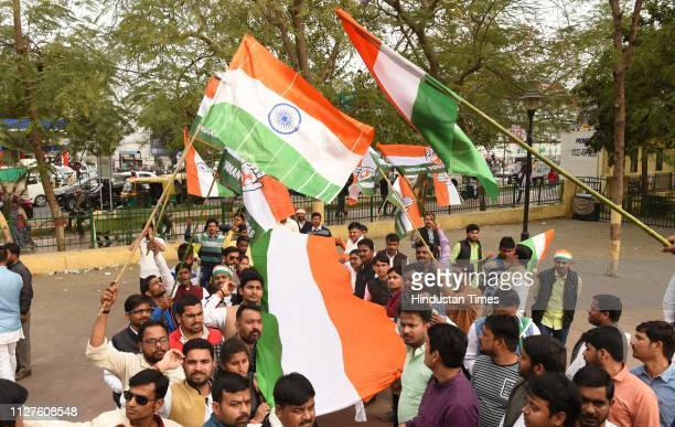 Youth Congress workers hold flags as they celebrate the IAF air strikes across LoC on February 26 2019 in Lucknow India Indian forces carried out a...