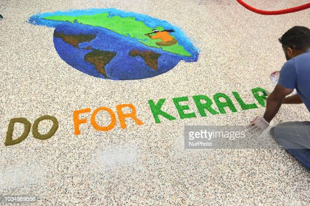 Youth create a colourful rangoli with the words 'Do for Kerala' as members of the Canadian Malayalee community take part in a fundraiser for the...