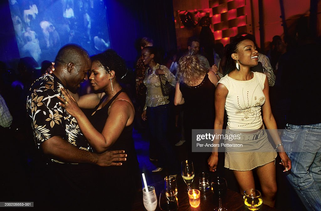 Youth dance in Johannesburg nightclub : Stock Photo