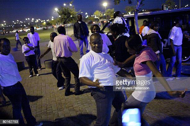 Youth dance the street after a Church service on May 6 2007 in Soweto South Africa Soweto is South Africa's largest township and it was founded about...