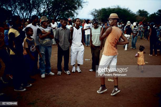 Youth dance to Kwaito music during a music festival on December in the Meadowlands section of Soweto Johannesburg South Africa Kwaito was born in the...