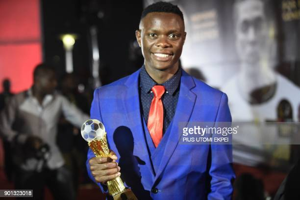 Youth Footballer of the Year and Zambian striker Patson Daka holds his trophy during the African Footballer of the Year Awards ceremony at the...