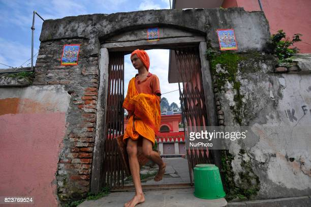 A youth from Hindu school Bhagwat Sanyaas Aashram Gurukul arrives to performing rituals offering during Janai Purnima festival or Rakchhya Bandhan at...