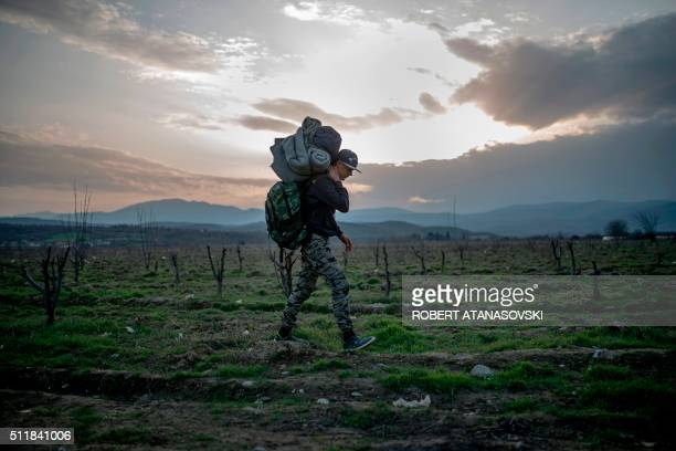 TOPSHOT A youth from Syria crosses the GreekMacedonian border near the town of Gevgelija on February 23 2016 Greece has expressed displeasure to the...