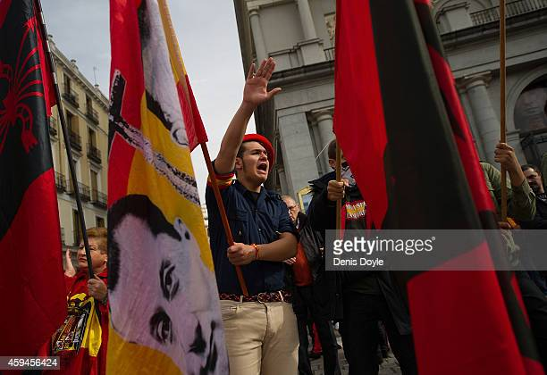 A youth gives the fascist salute during the 39th anniversary of the death of Spanish dictator General Francisco Franco at Plaza Oriente square on...