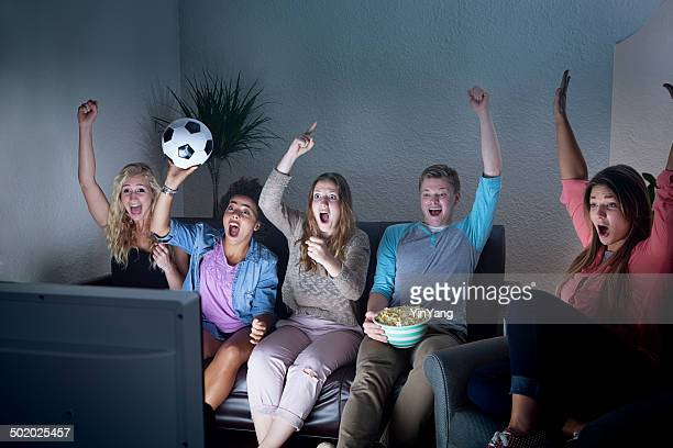 Youth Group Watching Soccer Game on TV Together