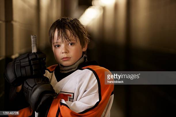 youth hockey player - ice hockey stock pictures, royalty-free photos & images