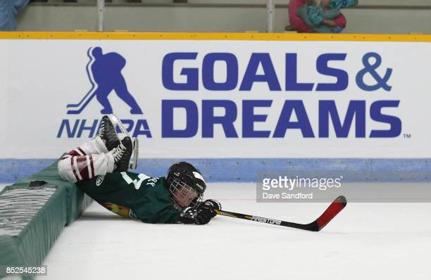 O'LEARY PE SEPTEMBER 23 A youth hockey player trips over a barrier in the on ice clinic during NHL Kraft Hockeyville Canada on September 23 2017 at...