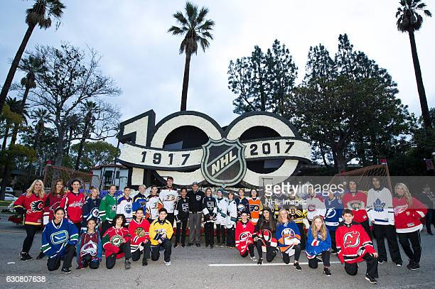 Youth hockey players wearing jerseys for all 30 NHL clubs pose with longtime Los Angeles Kings broadcaster Bob Miller in front of the NHL Centennial...