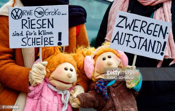 Youth hold placards outside the headquarters of the social democratic SPD party to protest against a new coalition government on February 4 2018 in...