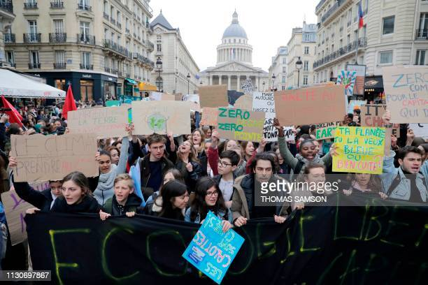 Youth hold signs during a demonstration against climate change on March 15 2019 near the Pantheon in Paris The worldwide youth protests were inspired...