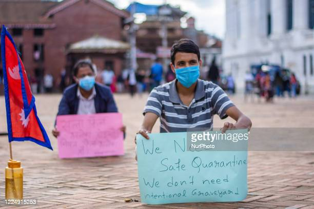 Youth holds a play card in a protest against government demanding better response to fight against coronavirus disease at Kathmandu, Nepal on Monday,...