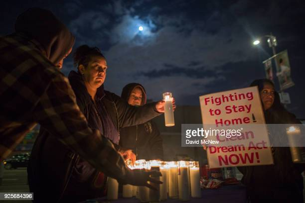 Youth immigrants known as Dreamers who grew up in the United States after arriving with their undocumented parents and supporters light candles...