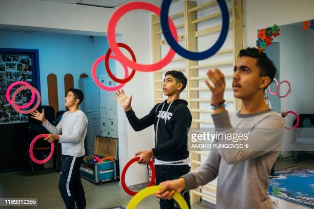 Youth juggle with rings at the headquarters of an NGO in Bucharest on November 7 2019 As Romania commemorates 30 years since the collapse of...