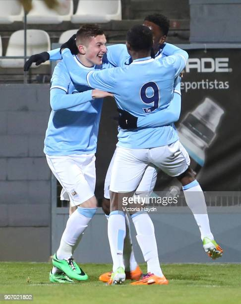 Youth League Atletico Madrid v Manchester City Cerro del Espino Stadium Manchester City's Sinan Bytyqi Thierry Ambrose and Devante Cole celebrating
