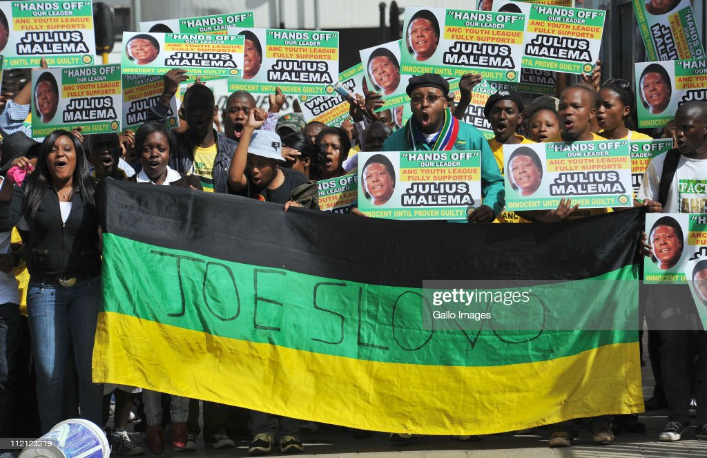 ANC Youth League members protest in support of their leader Julius Malema outside the High Court on April 12, 2011 in Johannesburg, South Africa. Malema appeared in court for the second day on charges of inciting hatred for singing the song 'Shoot The Boer', laid against him by Tshwane-based lobby group AfriForum.