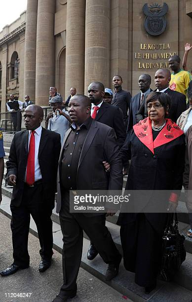 ANC Youth League president Julius Malema and ANC stalwart Winnie MadikizelaMandela leave the High Court on April 11 2011 in Johannesburg South Africa...
