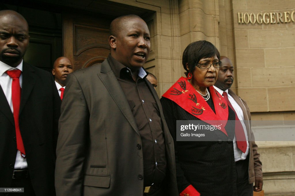 ANC Youth League president Julius Malema (C) and ANC stalwart Winnie Madikizela-Mandela leave the High Court on April 11, 2011 in Johannesburg, South Africa. Malema appeared on charges of inciting hatred for singing the song 'Shoot The Boer', laid against him by Tshwane-based lobby group AfriForum.