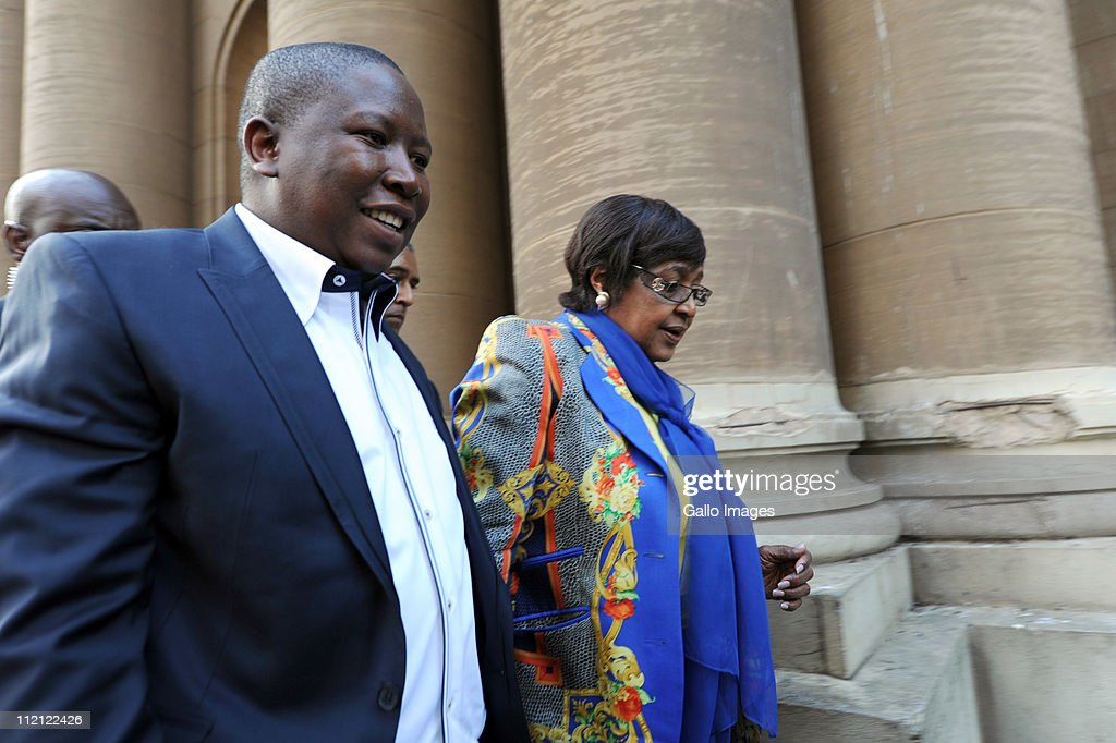 ANC Youth League president Julius Malema and ANC stalwart Winnie Madikizela-Mandela leave the High Court on April 12, 2011 in Johannesburg, South Africa. Malema appeared in court for the second day on charges of inciting hatred for singing the song 'Shoot The Boer', laid against him by Tshwane-based lobby group AfriForum.