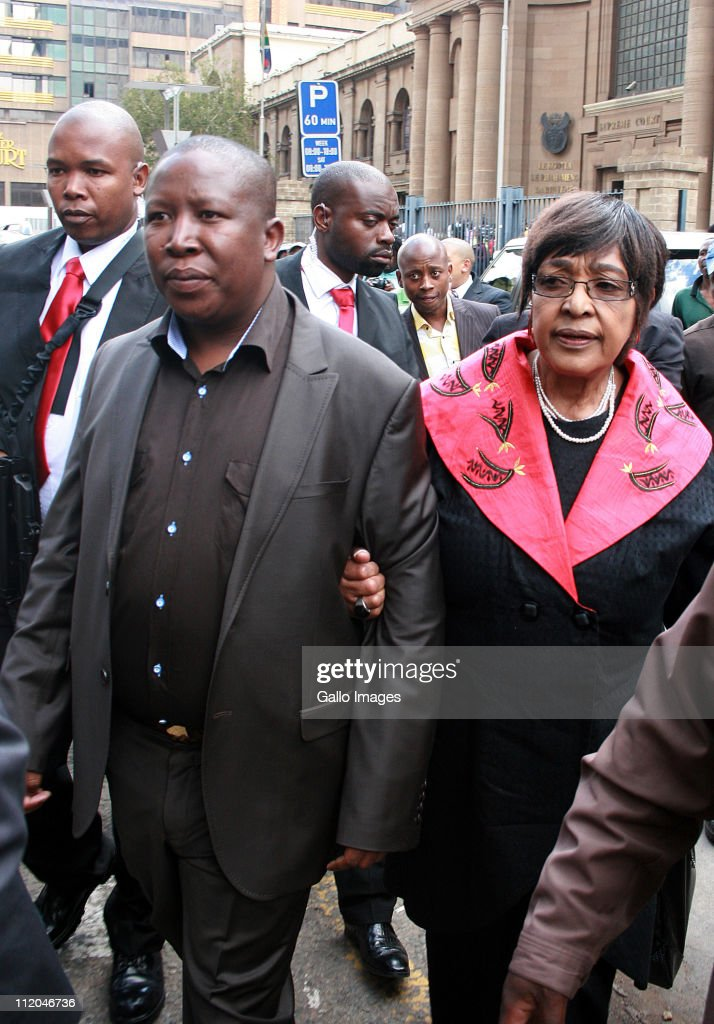 Youth League president Julius Malema and ANC stalwart Winnie Madikizela-Mandela outside the High Court on April 11, 2011 in Johannesburg, South Africa. Malema appeared on charges of inciting hatred for singing the song 'Shoot The Boer', laid against him by Tshwane-based lobby group AfriForum.