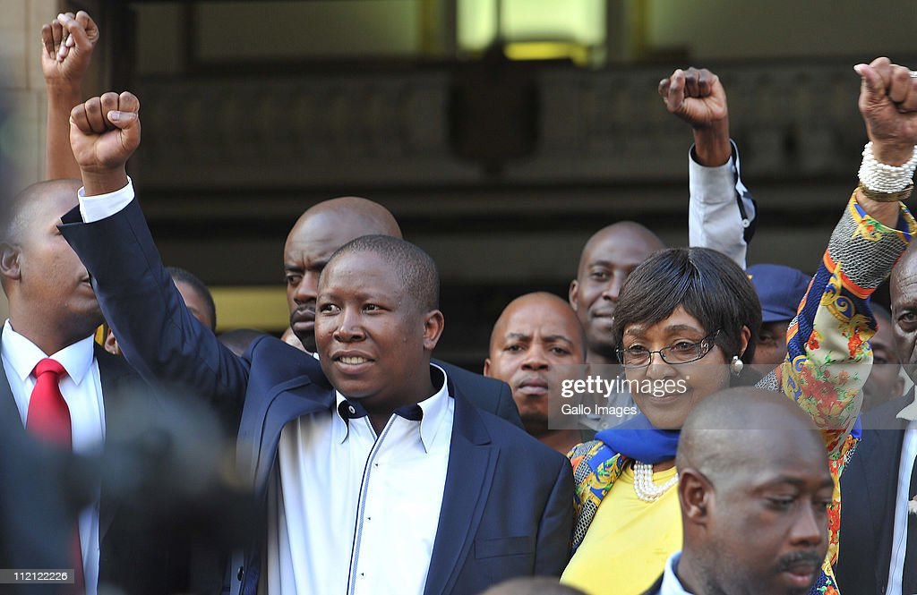 ANC Youth League president Julius Malema and ANC stalwart Winnie Madikizela-Mandela raise their fists as they leave the High Court on April 12, 2011 in Johannesburg, South Africa. Malema appeared in court for the second day on charges of inciting hatred for singing the song 'Shoot The Boer', laid against him by Tshwane-based lobby group AfriForum.
