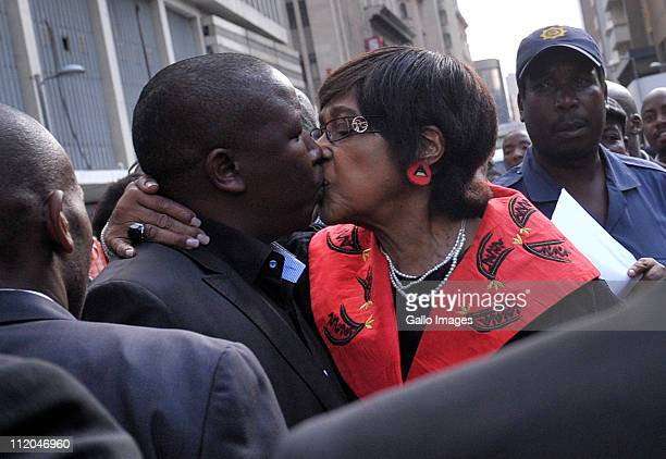 ANC Youth League president Julius Malema is embraced by ANC stalwart Winnie MadikizelaMandela outside the High Court on April 11 2011 in Johannesburg...