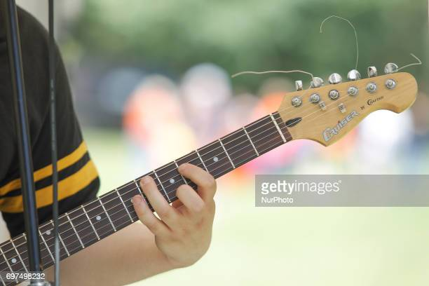 A youth metal band is seen playing during the summer season opening festival at Myslecinek park on 18 June 2017