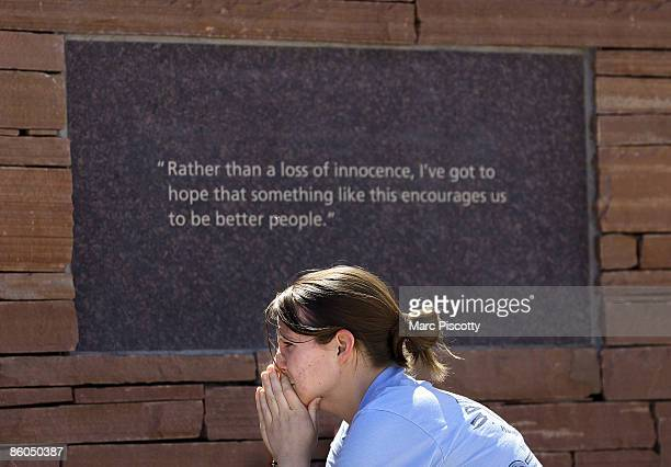 Youth pastor Julie Outzen of Denver commemorates the tenyear anniversary of the Columbine High School shootings at the Columbine Memorial Park April...