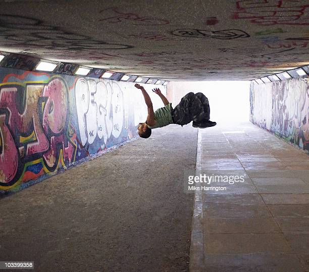youth performing parkour - somersault stock pictures, royalty-free photos & images