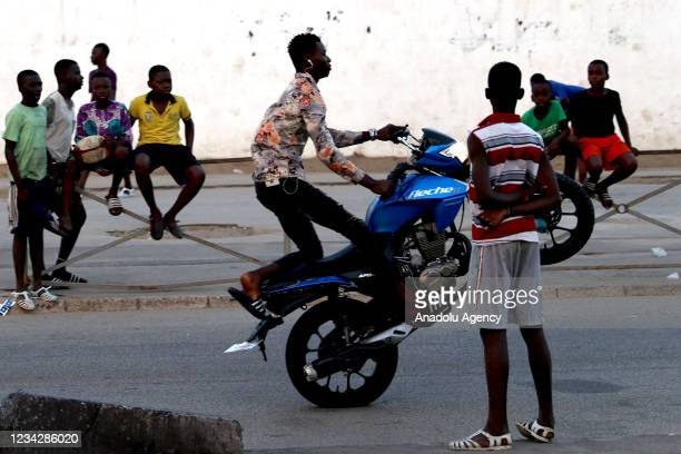 Youth performs on a motorcycle on a street in Abidjan, Ivory Coast on July 28, 2021.
