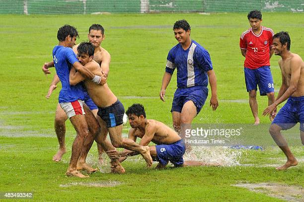 Youth playing kabaddi during pleasant weather rainfall on August 9 2015 in Noida India Heavy rains caused major waterlogging in many areas leaving...