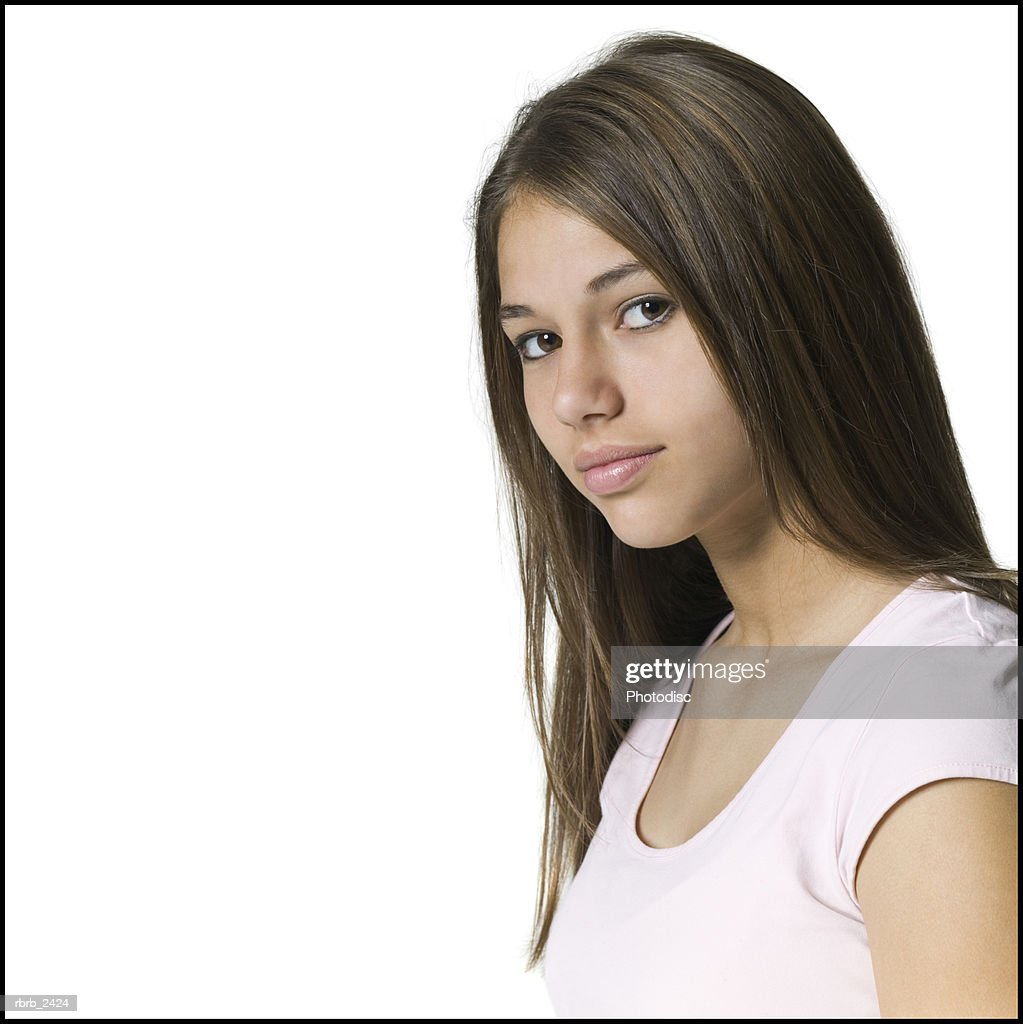 youth portrait of a teenage female as she turns and slightly smiles : Foto de stock