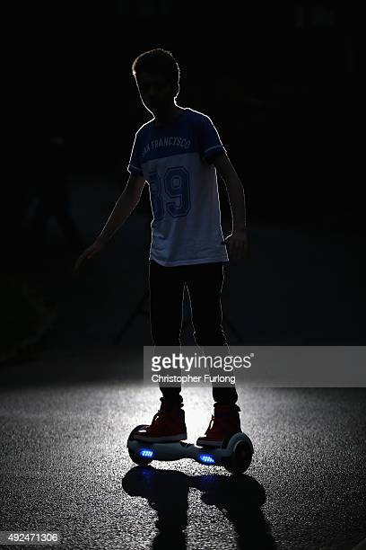 A youth poses as he rides a hoverboard which are also known as selfbalancing scooters and balance boards on October 13 2015 in Knutsford England The...