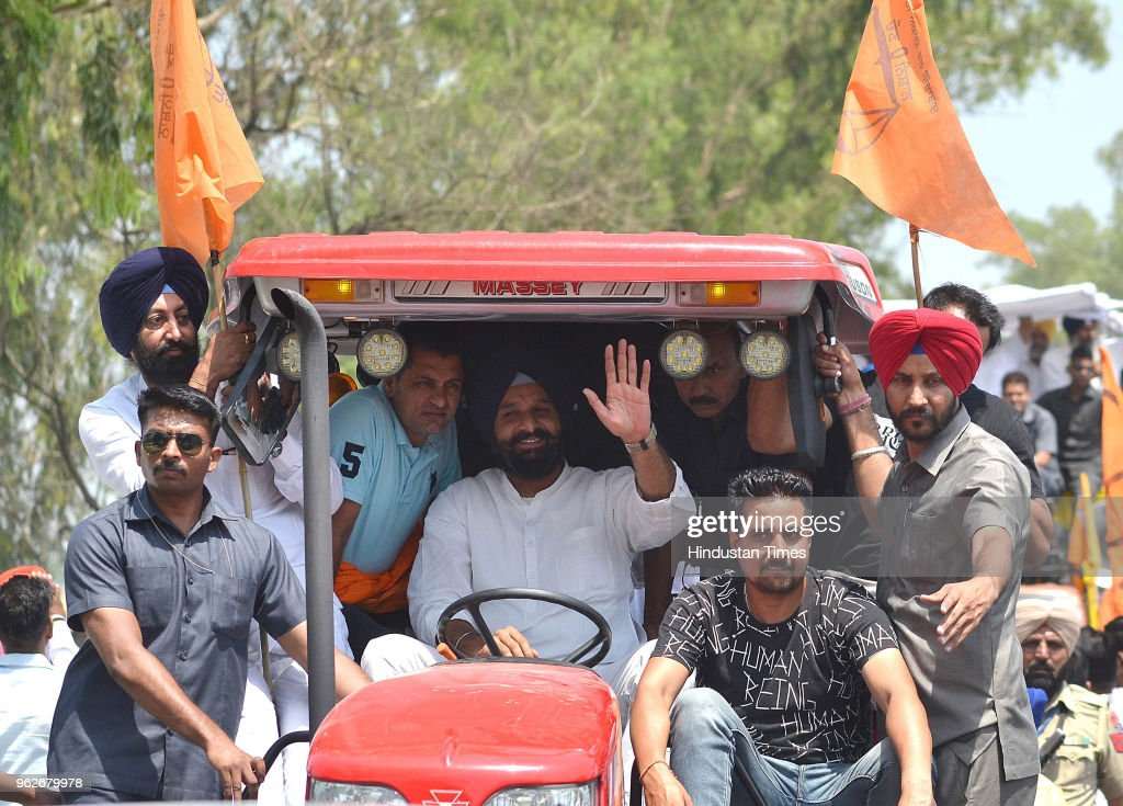 SAD youth president Bikarm Majithia waving during road show ahead of Shakhkot Bypoll near Lohian Khas on May 26 2018 in Jalandhar India Shiromani...