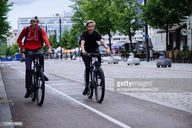 Youth ride their bicycles on August 24, 2020 in Lahti, where a pilot project is implemented to quantify the personal carbon footprint. - Inhabitants...